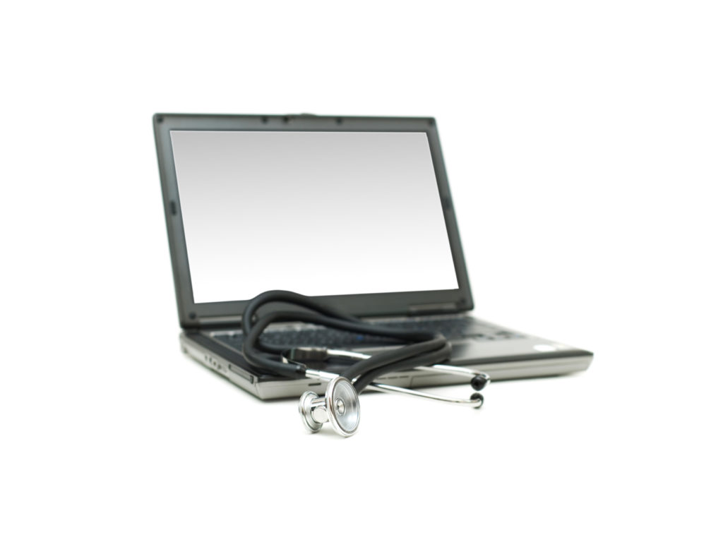Stethoscope and laptop illustrating concept of digital security